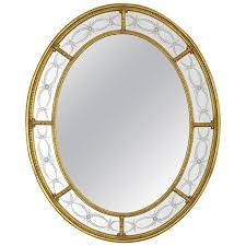 adam style oval mirror 22 karat gold with engraved panels at 1stdibs