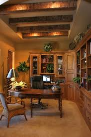 mediterranean home office with exposed beam by milestone studio
