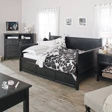 high dark brown wooden daybed with drawers and wooden shelves