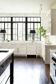 gorgeous black framed windows in open airy kitchen via freshome