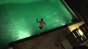 Pool At Night Young Teenager Jumping Into Swimming Pool At Night Slow Motion