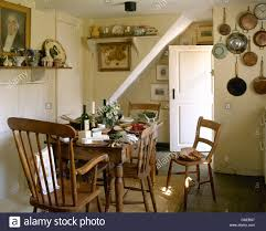 Simple Wooden Chairs And Old Pine Table Set For Lunch In Cottage - Old pine kitchen table