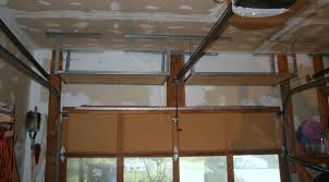 Hanging Shelves From Ceiling by Overhead Garage Shelves Using Slotted Angle Iron