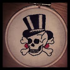 handmade stitched wall hanging of sailor jerry skull and top
