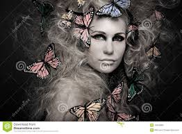 butterfly hair woman with butterfly in big curly hair on black stock photos