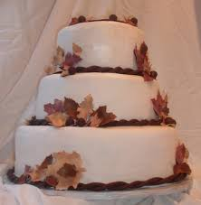 fall leaves wedding cake with burgundy brown and beige edible