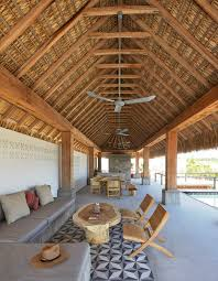Mexican Thatch Roofing by Baaq Completes Seaside House In Mexico With An Elevated Pool And A