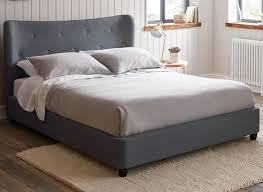 warne grey fabric upholstered bed frame dreams