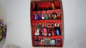 how to create a recycled jewelry and nail polish holder diy