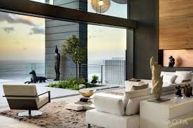 Beach Living Room by Modern Private Residence With Dramatic Living Room Overlooking The