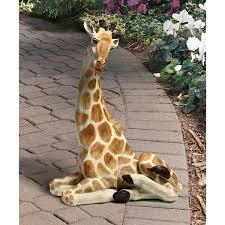 design toscano zari the resting giraffe statue