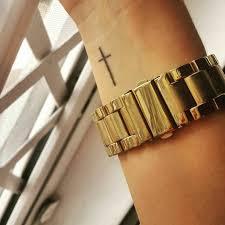 minimal small cross on wrist