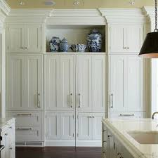 floor to ceiling storage cabinets butter yellow ceiling design ideas