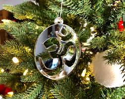 om ornament etsy