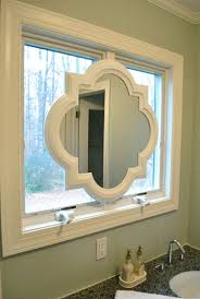 painting our quatrefoil mirror over the sink bathroom mirrors