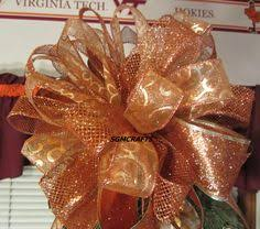 copper wired ribbon tree topper bow copper tree
