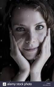 dark haired women cute dark haired women with grey eyes her head resting on hands