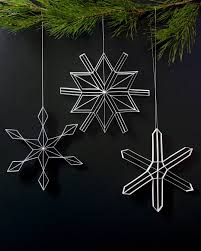 beautiful quilled snowflake ornaments and poinsettia by judith and