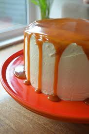 chocolate layer cake with vanilla frosting and salted caramel