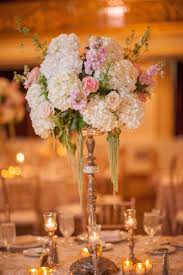 reception décor photos tall golden centerpiece inside weddings