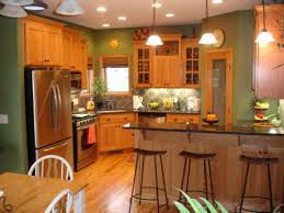 the oak cabinets look great with asparagus walls dark back splash
