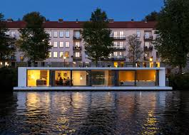 floating home by 31 architects moored on amsterdam river