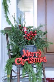 73 Best Deco Garland Images by Christmas Front Porch Decorating With Porch Pots And Fresh Garland