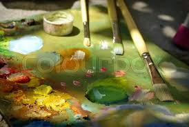 artist brush mix color oil painting on palette stock photo