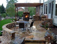 stamped concrete patio looks like large pavers deck