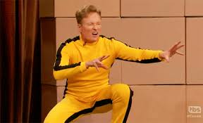 bruce yellow jumpsuit conan dons bruce s yellow jumpsuit and has his kicked by