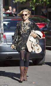 s elsa ugg boots elsa pataky steps out in jungle print mini dress and suede boots