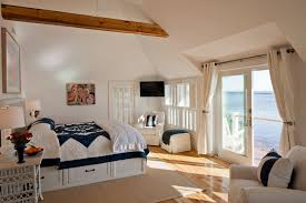 plantation shutters for sliding doors bedroom beach with area rug