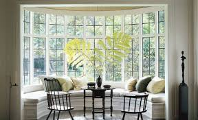 fascinating pictures of bay windows with curtains images design rounded bay window home decorating with various pillows and black chairs tables indoor plant decoration