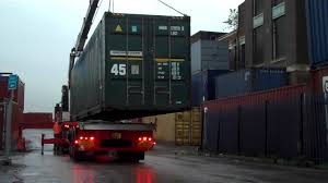 shipping container for sale being loaded on to delivery lorry