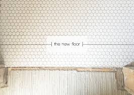 powder room renovation a new floor white hex tile with light