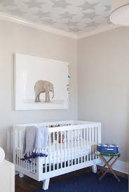 white and blue nursery with baby elephant print over oeuf sparrow