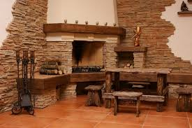 big village style stacked stone corner fireplace dining room