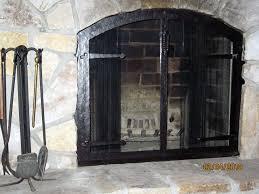 modern glass fireplace doors modern style arched glass fireplace doors with stoll fireplace