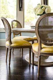 Round Dining Table Design Ideas - Round dining table with wicker chairs
