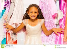 Small Beautiful Pics Small Beautiful African Stands Among Clothes Stock Photo