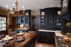 country black kitchen cabinets with hanging lighting and wood
