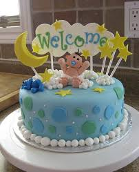 round powder blue baby shower cake with yellow crescent moon and