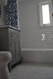 Grey Tile Bathroom by Bathroom With Dark Gray Tile Floors Wood Floors