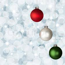 white red and green christmas ornaments on silver bokeh