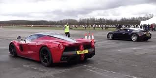 ferrari laferrari bugatti veyron and ferrari laferrari go head to head in a straight