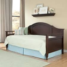 rustic espresso wooden daybed with blue valance and white bedding