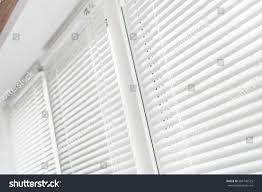 windows white venetian blinds stock photo 683740525 shutterstock