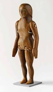 wooden doll carved by eric gill for his 1910