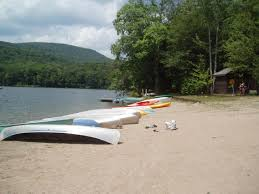 boats on the beach at little pond campground nysdec campgrounds