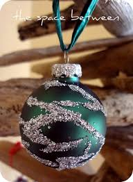 update scratched baubles with glue and glitter totally green